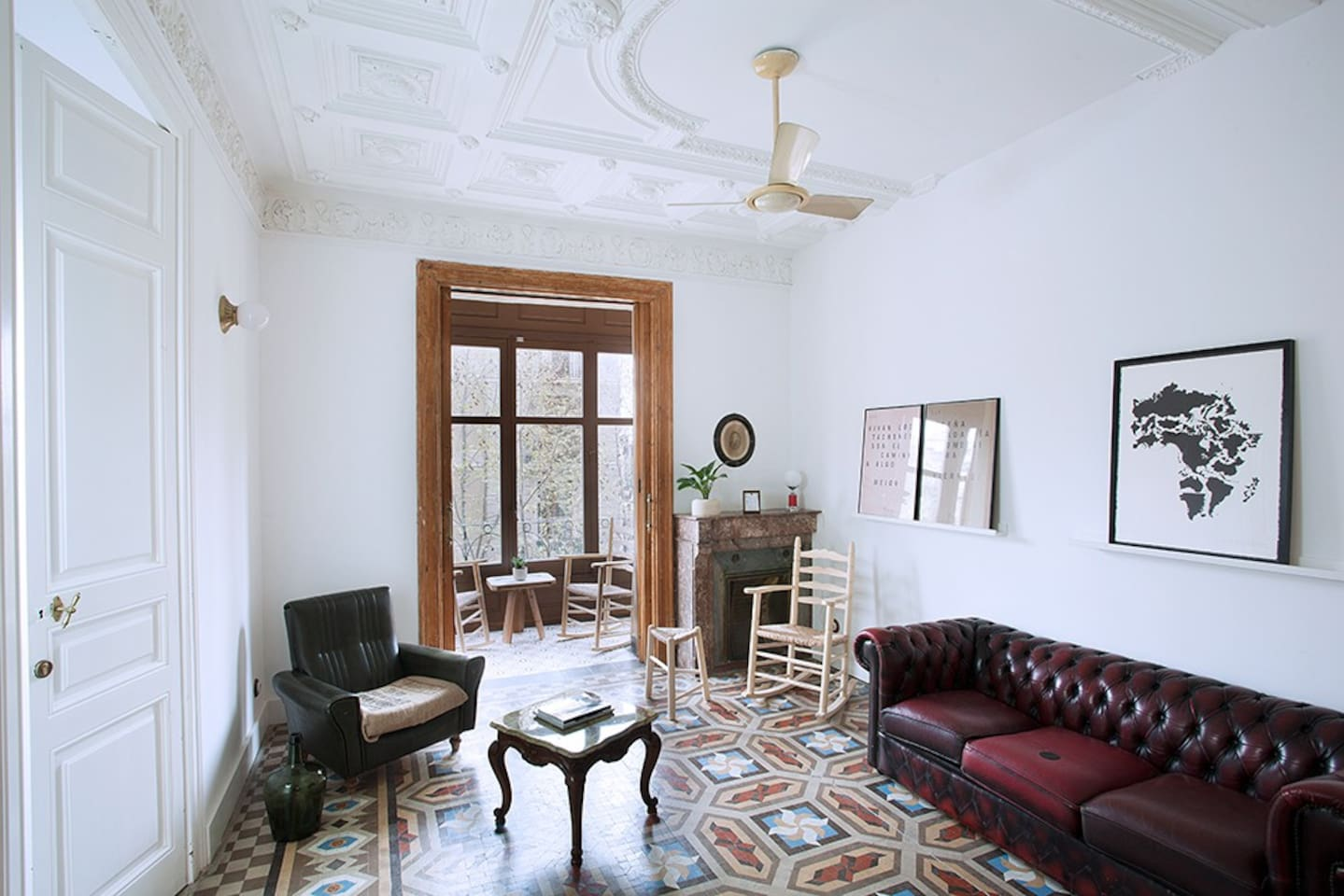 Living room with vintage and locally made furniture, and Catalan Modernism features like mosaic floors, 1900 carpentry and decorative ceilings.