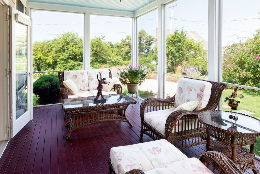 The covered porch with comfortable seating makes a nice spot for morning coffee.