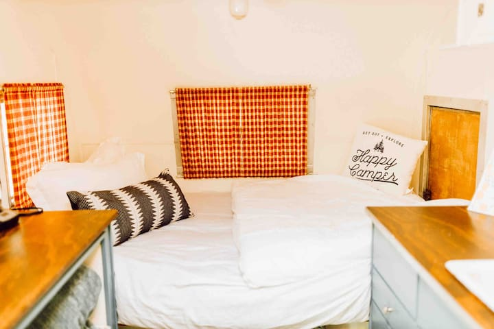 Completely remodeled and ready for guests! The camper has a cozy double bed that can sleep two guests. Fresh linens and pillows are provided