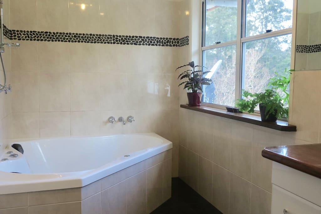 Ensuite bathroom with a bush view.
