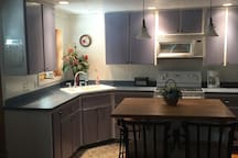 Fully furnished kitchen refrigerator, stove, microwave ,coffee maker, toaster, pots and pans, cups, glasses, all cooking utensils! Sorry you have to do the cooking! Had a 4 rating once because they said not enough serving bowls... we have plenty now.... lol....