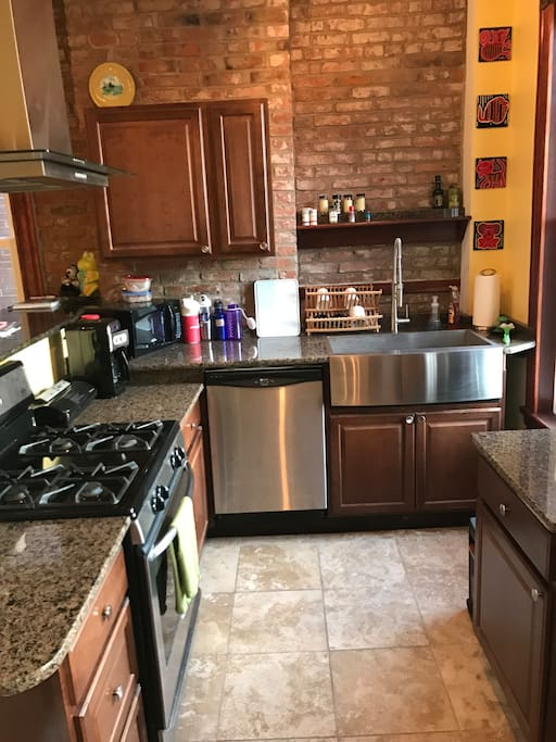 Custom kitchen with farm apron sink and gas stove range