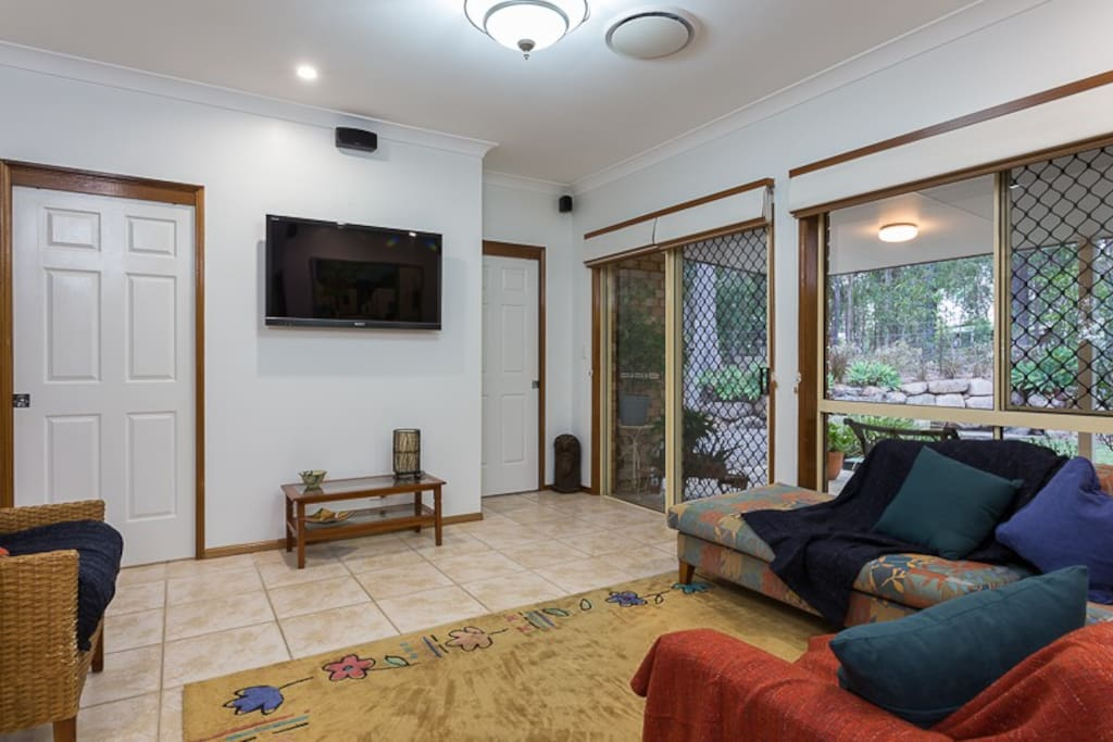 Spacious, light living area with tv, plus front and rear patios.