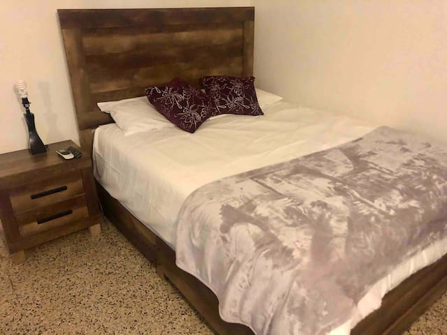 Bedroom with 1 queen bed.  There is space for an extra air mattress(included)
