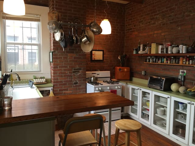 Gorgeous shared kitchen with multiple coffee-making options -- French press or Clever coffee dripper with locally-roasted Nicholas coffee provided. Also, access to laundry in basement is through this room.