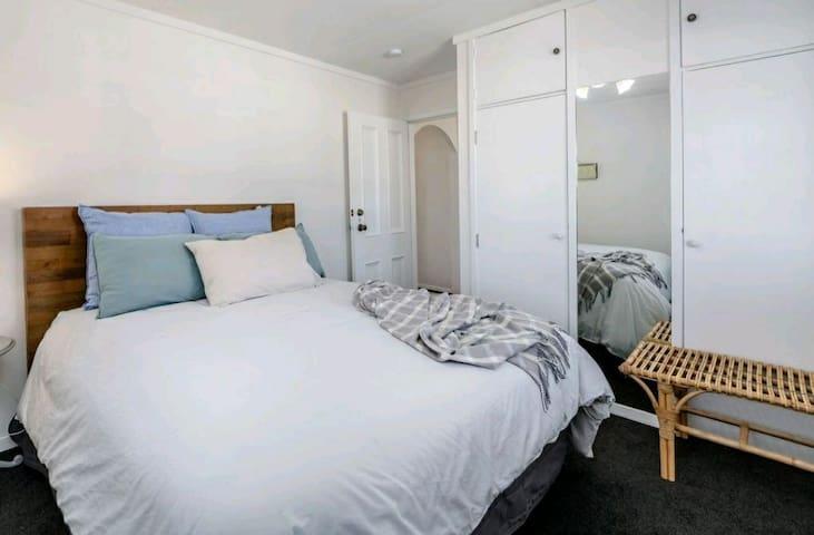 Queen bedroom 1.