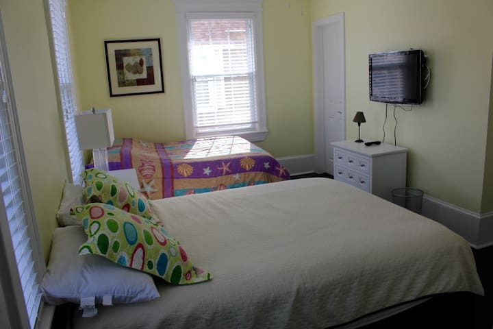 bedroom #3 with 2 queen beds.  folding crib available for use and stored in the closet.
