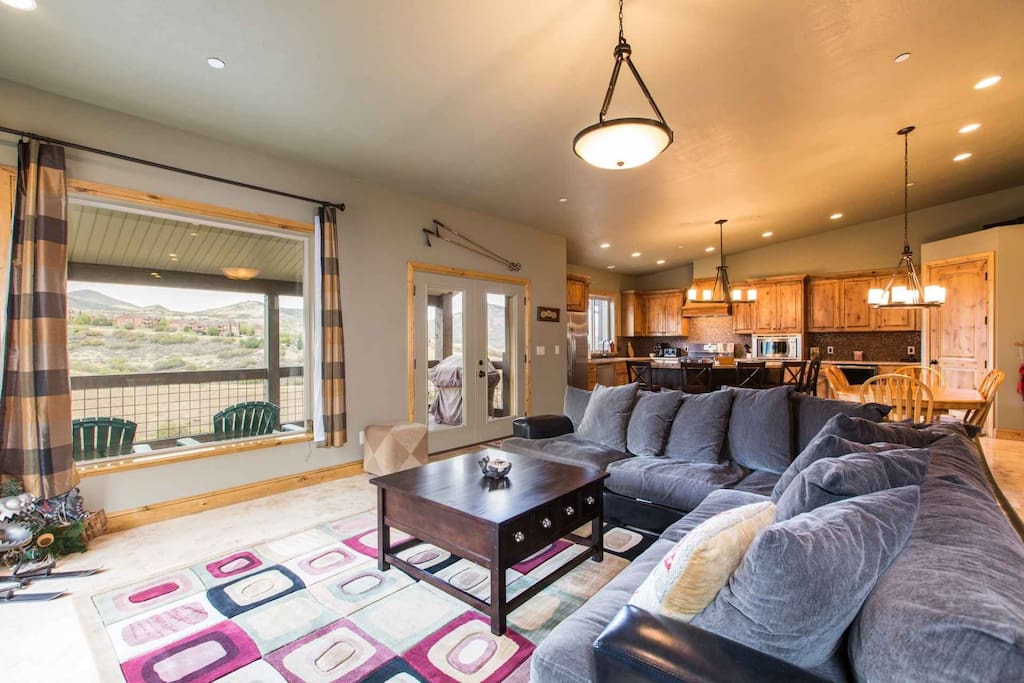 The main floor is a walk-in and the entire home is tastefully decorated with a modern-mountain theme and comfortably furnished.