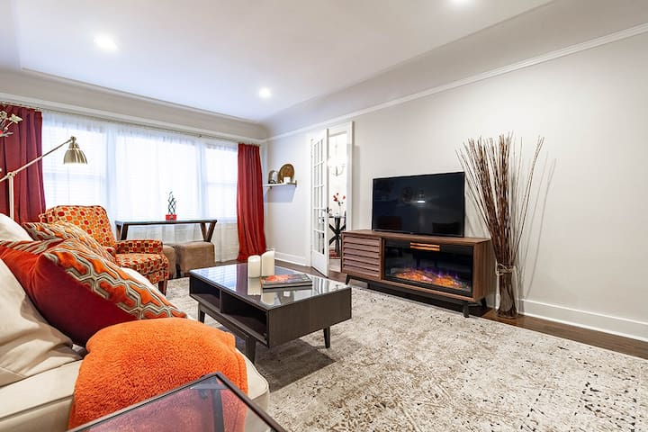 Living Room with Fireplace + Smart  T.V