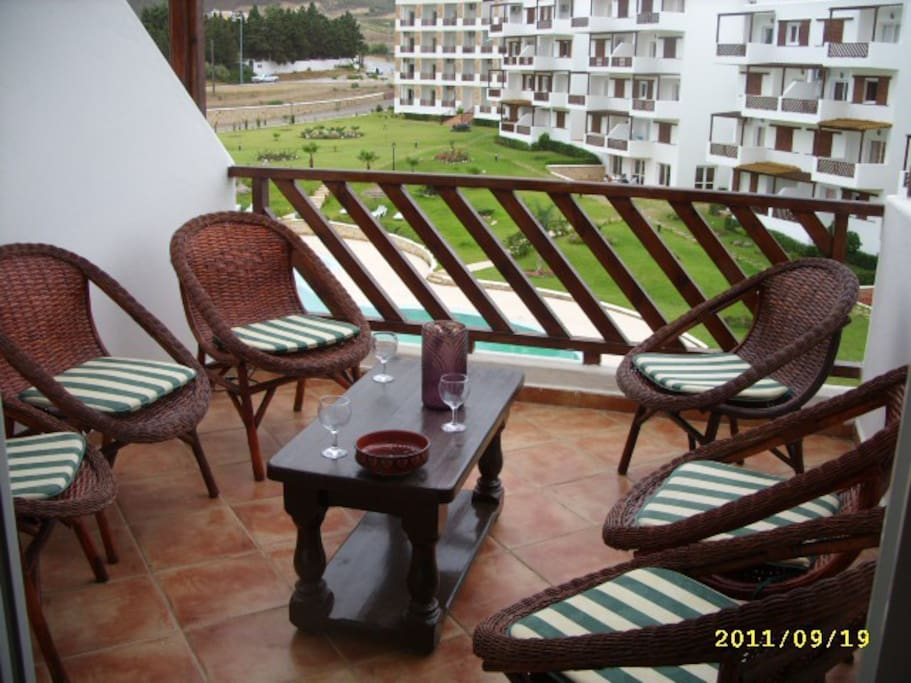 with table & chairs for six and an umbrella, overlooking
