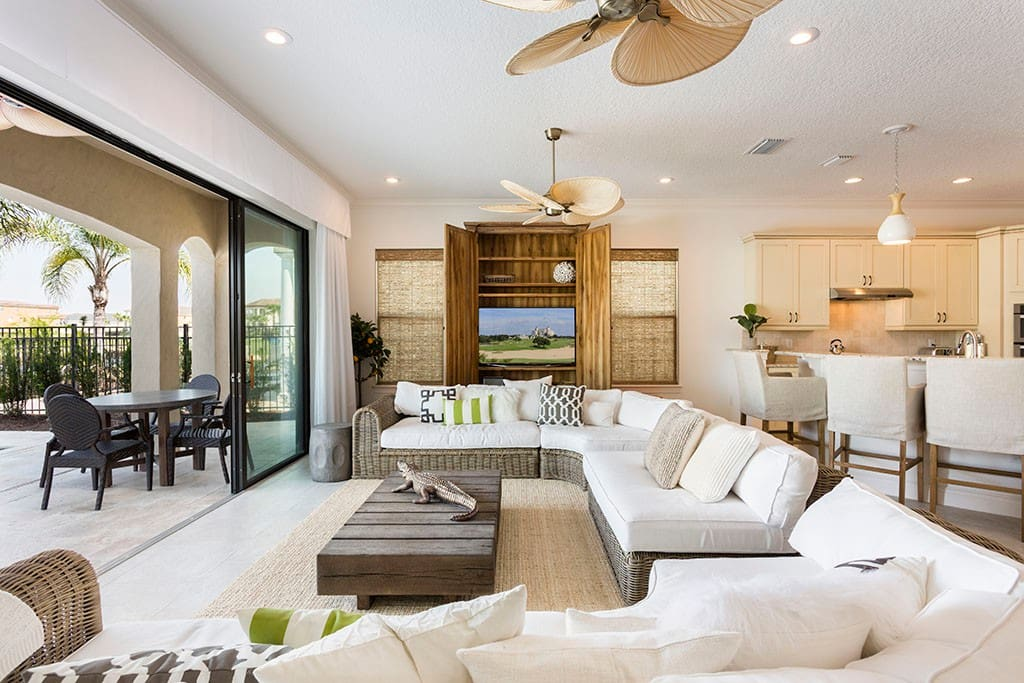 Large sliding glass doors connect the outdoor and indoor living areas.