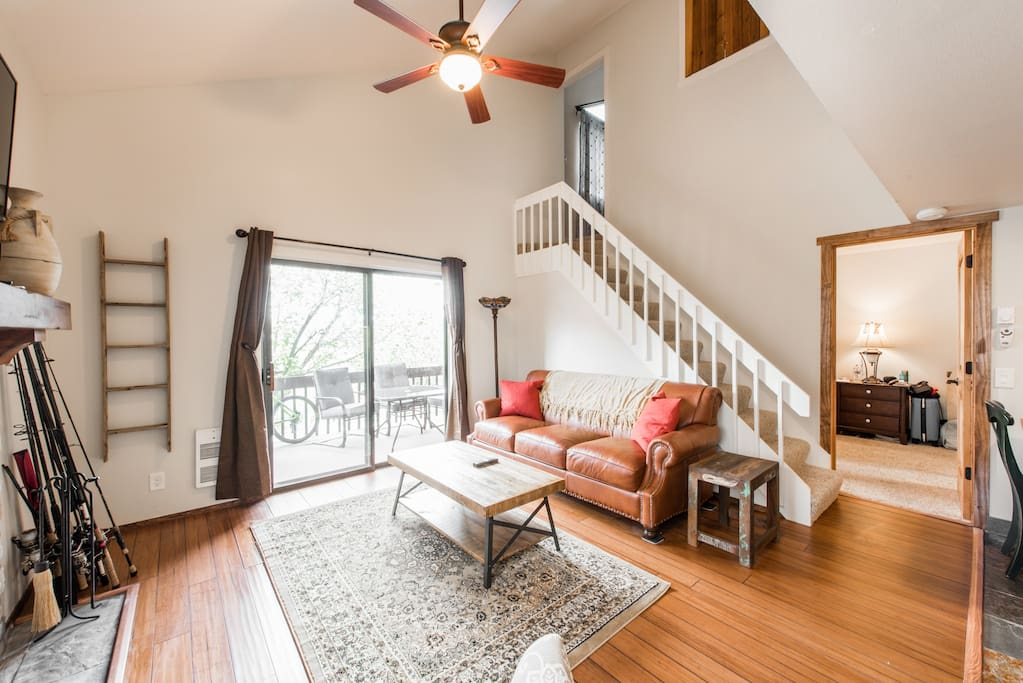 High ceiling, rustic accents, hardwood floors, first floor master &  enclosed loft space with 5 beds upstairs