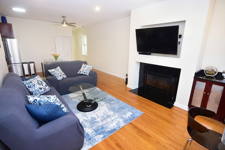 """50"""" Flat Screen, Mondern Furniture - New Leather Couches with Clean Couch Covers, Swivel Coffee Table. Nearby Beverage Center with Mini Fridge."""