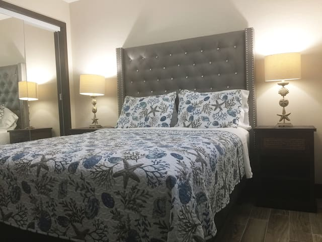 """Bedroom with Queen bed and 50"""" TV"""