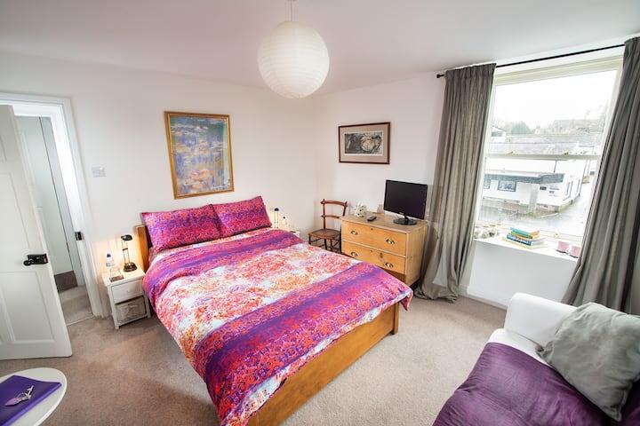 Bright Stylish Bedroom with Sofa & Guest Bathroom