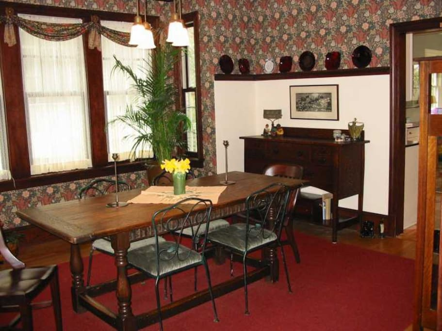 William Morris wallpaper embellishes the dining room