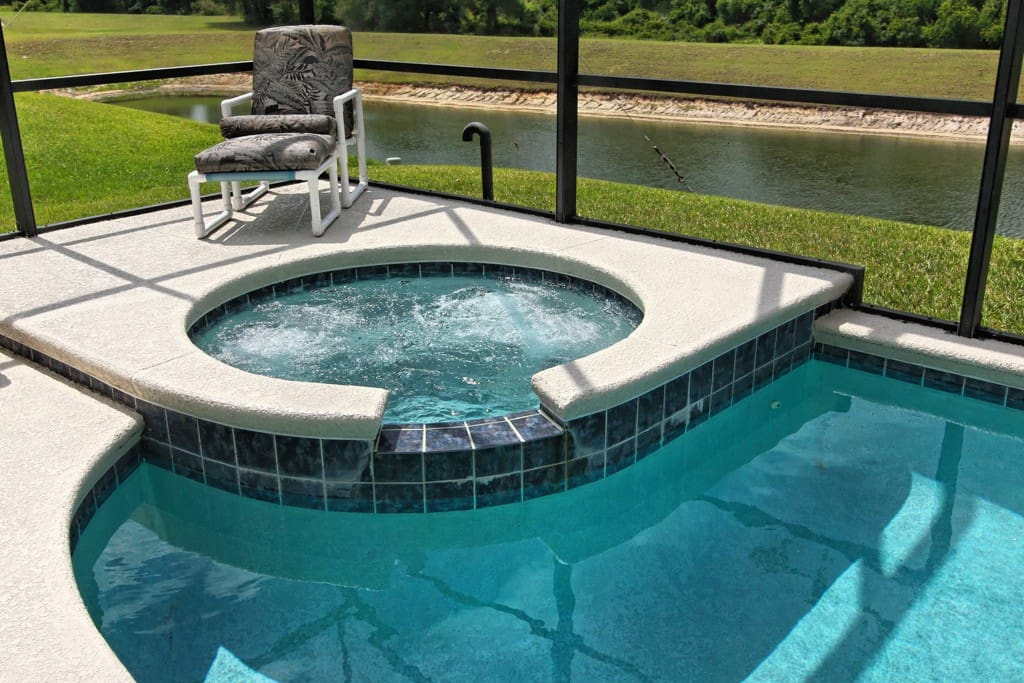 After an action-packed day with the family at the nearby theme parks of Orlando - sit in this spa that overlooks the water and conservation behind this home and let the bubbles soothe away any aches you may have gathered.