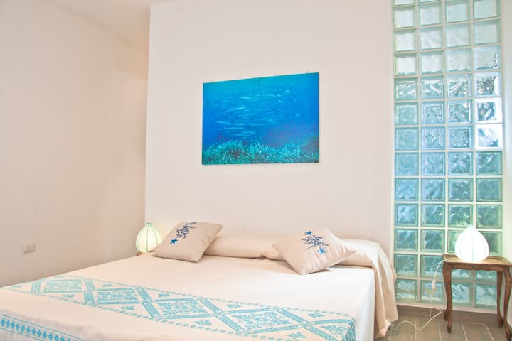 Room & terrace overlooking the sea