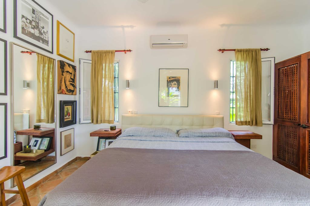Master bedroom with on suite, air conditioner and opens up the the private courtyard and pool area