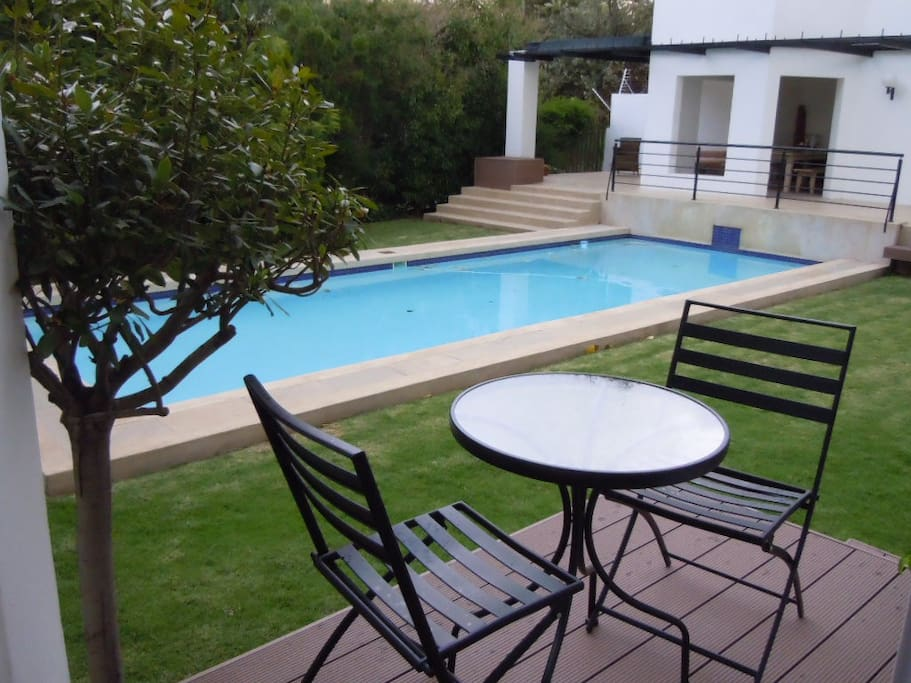 View from Suite 1 patio - guests are welcome to use the pool - towels provided