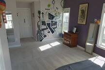 Enjoy the large space and custom mural.