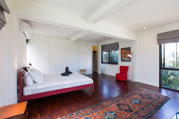 The bed room is spacious and has a clean look.