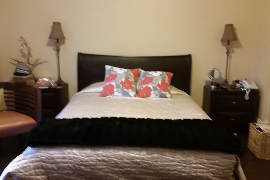Cozy queen size bed with crisp white super soft sheets.
