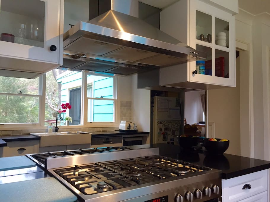 Newly renovated kitchen with mirror splash back to reflect the outside