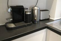 Nespresso coffee maker and boiling kettle and toaster - breakfast is ready with these!