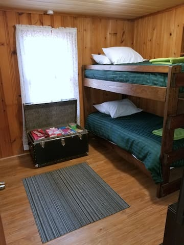 Bunk Beds and chest full of board games