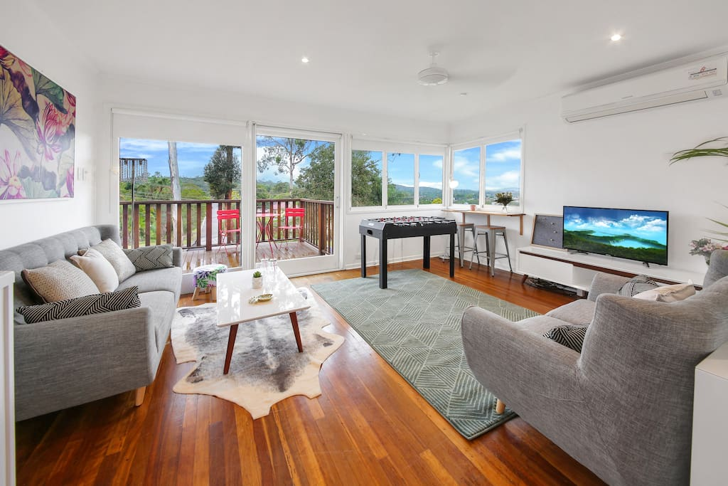 Spacious living room with a view and access to balcony
