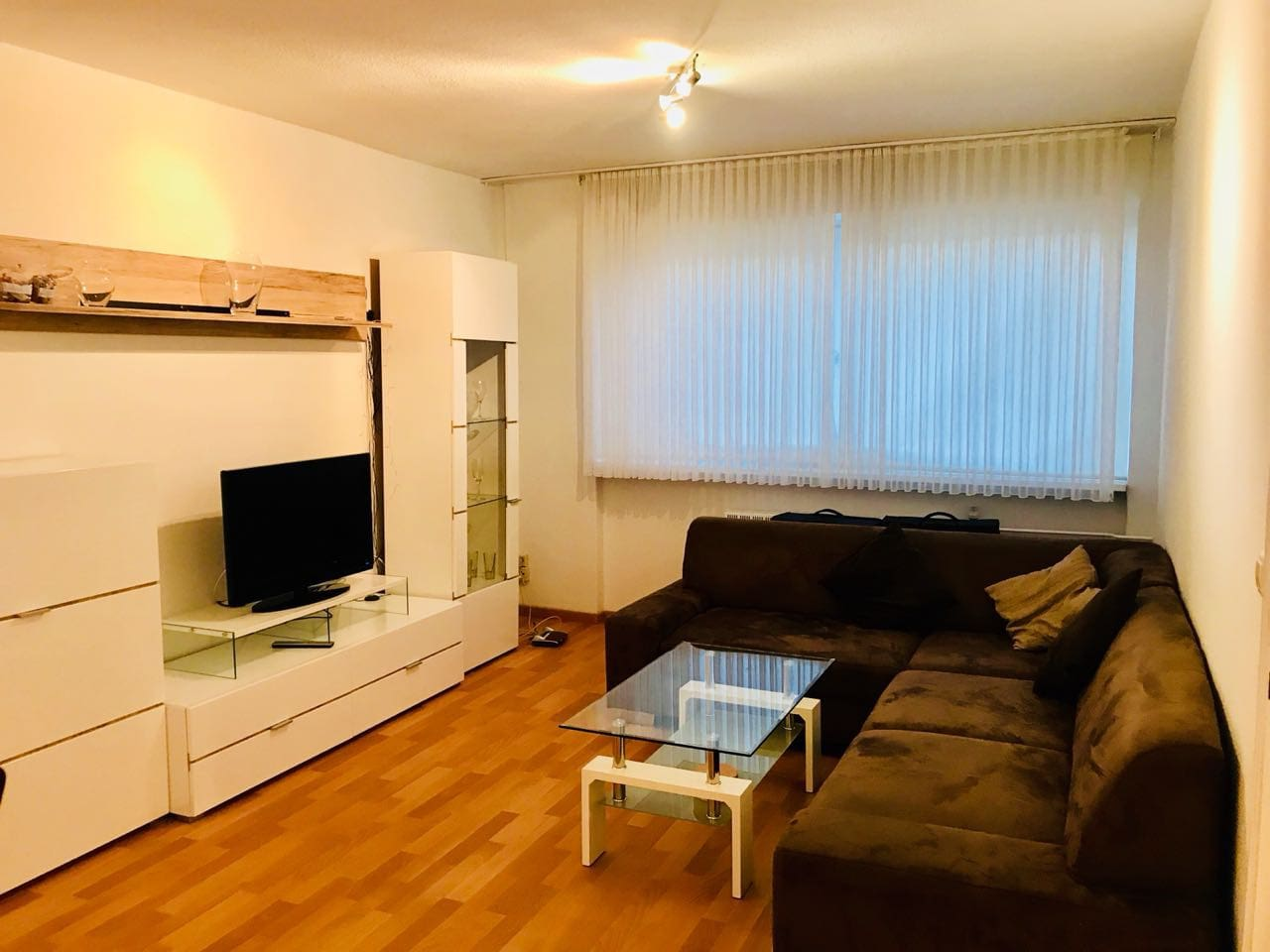 Living room with sofa bed, dining table, TV and Tea table