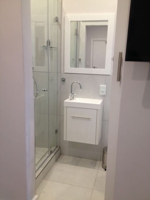 Our en-suite bathroom with a spacious shower