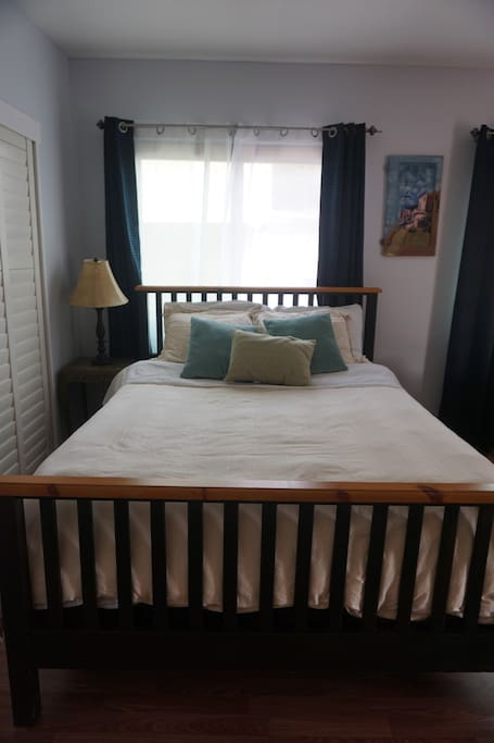 Queen bed with luxurious sheets and comforter. Additional sheets, comforter and blankets are available for use.
