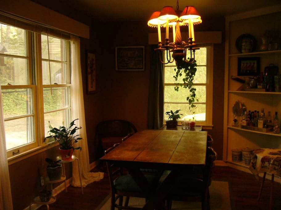 Lovey dinning room with lots of light and plenty of extra chairs.