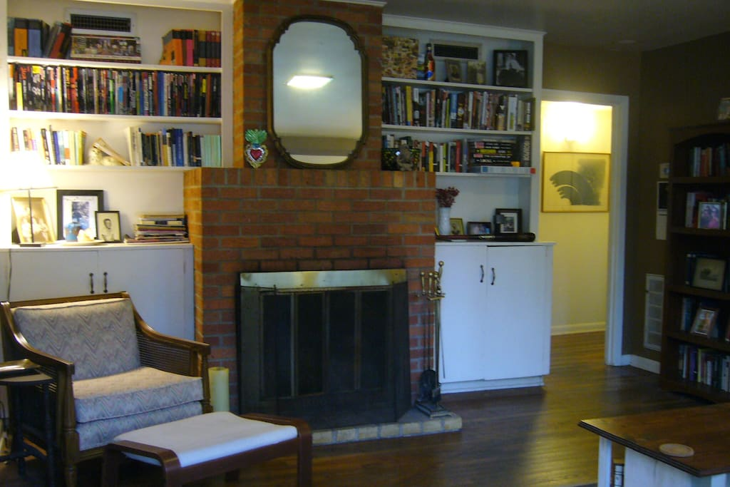 The living room with plenty of light, a fireplace comfortable seating.