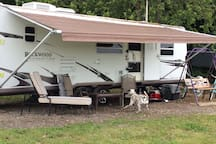 31 ft Rockwood travel trailer located on 25 acre hobby farm. Pet friendly and exceptionally peaceful surroundings.