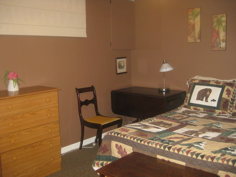 Comfortable bedroom with Queen bed, plenty of space for working or relaxing.