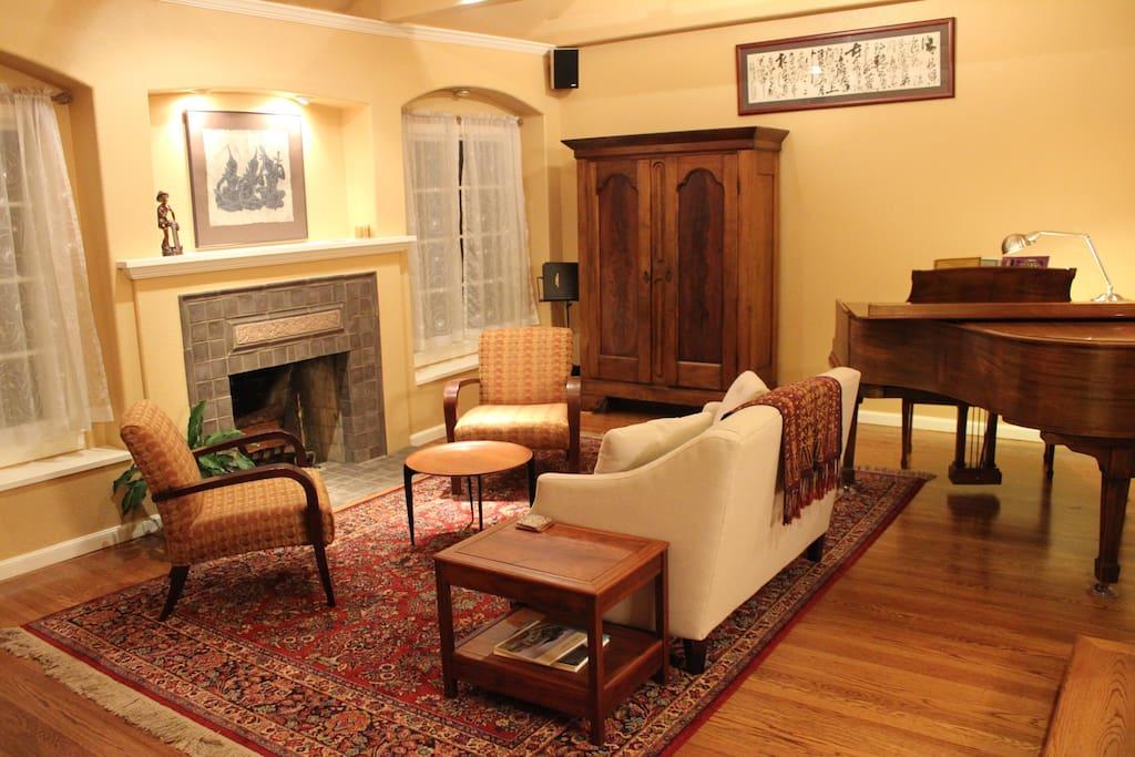 Livingroom, hardwood floors, baby grand piano.