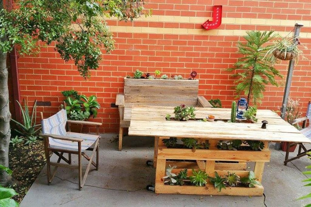 Outdoor courtyard with lots of plants!
