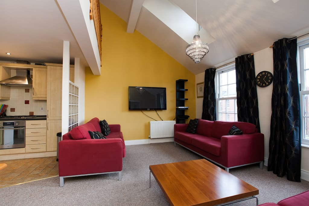 Open plan kitchen and lounge with flat screen TV (sofas now changed to clack leather and pull out sofa bed added)