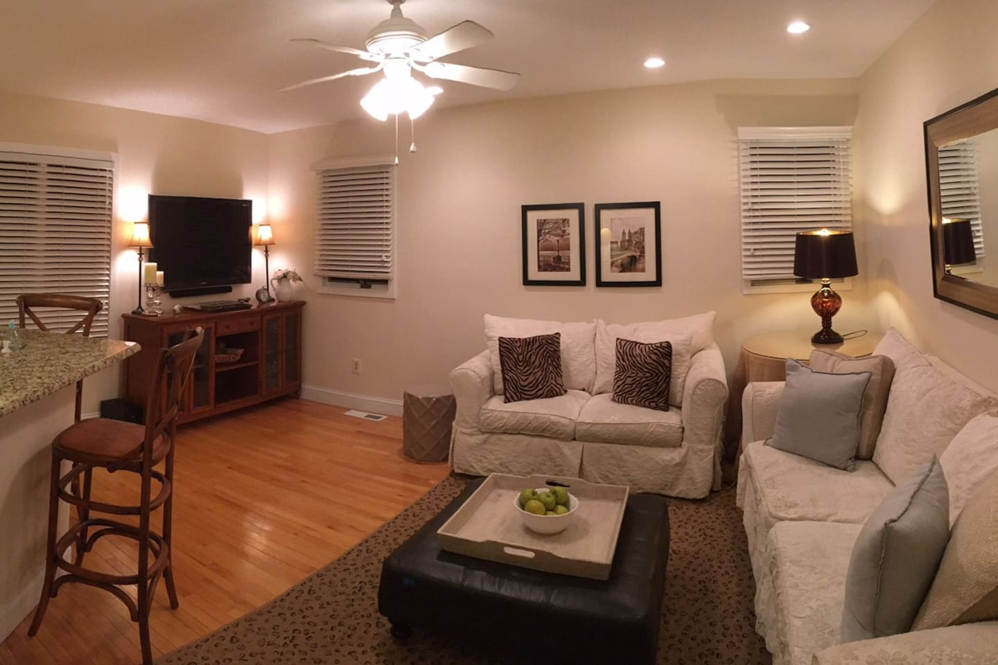 Living room with large flat screen tv, sound bar and two very comfortable couches (one is a full pull out)