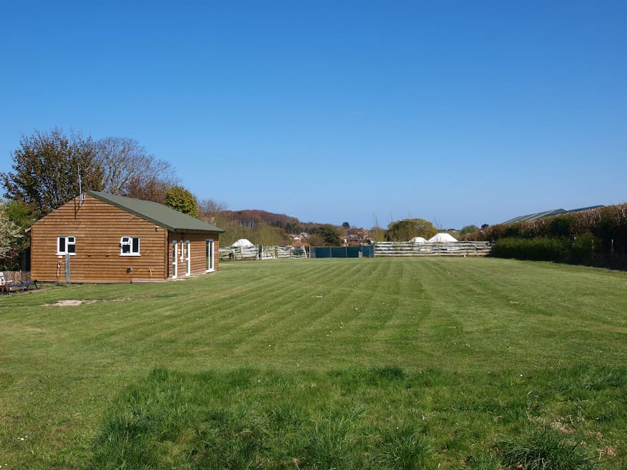 The Campsite, toilet block is the wood building