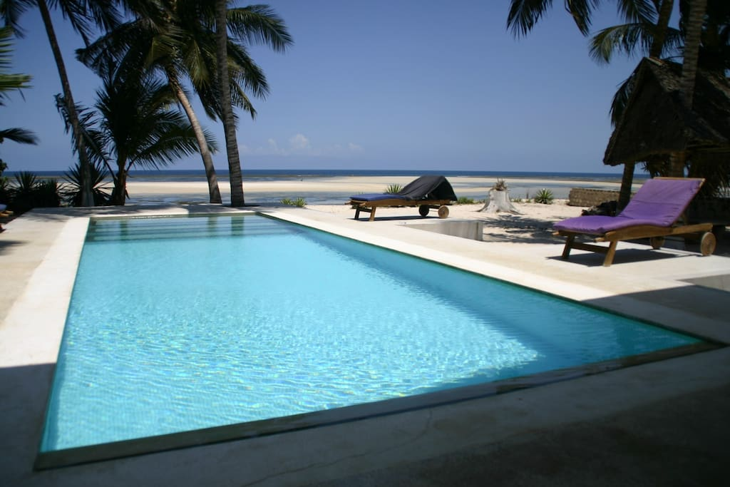 the pool is directly connecting the beach