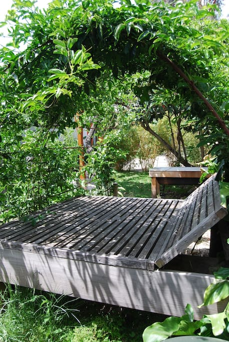 Passionfruit daybed and outdoor bathtub.
