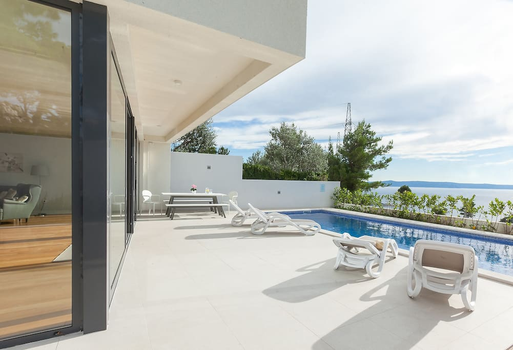 Large pool terrace with sea view
