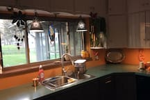 Shared kitchenette facing patio and spacious backyard.