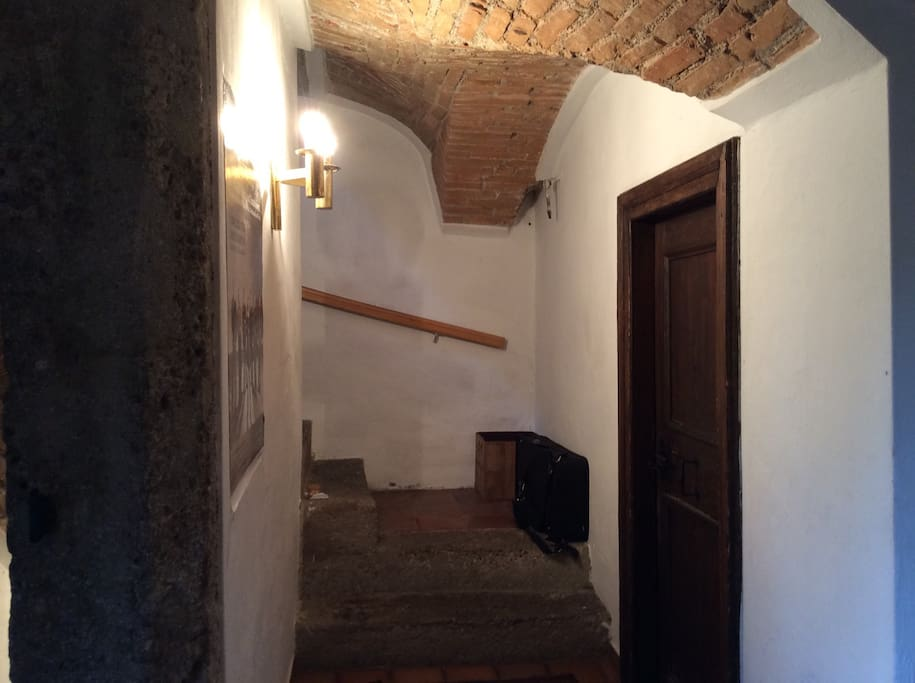Staircase with original doors into separate rooms!