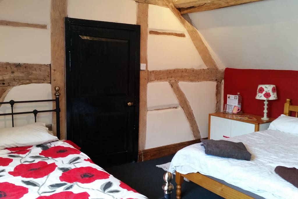 Beamed attic room up two flights of stairs
