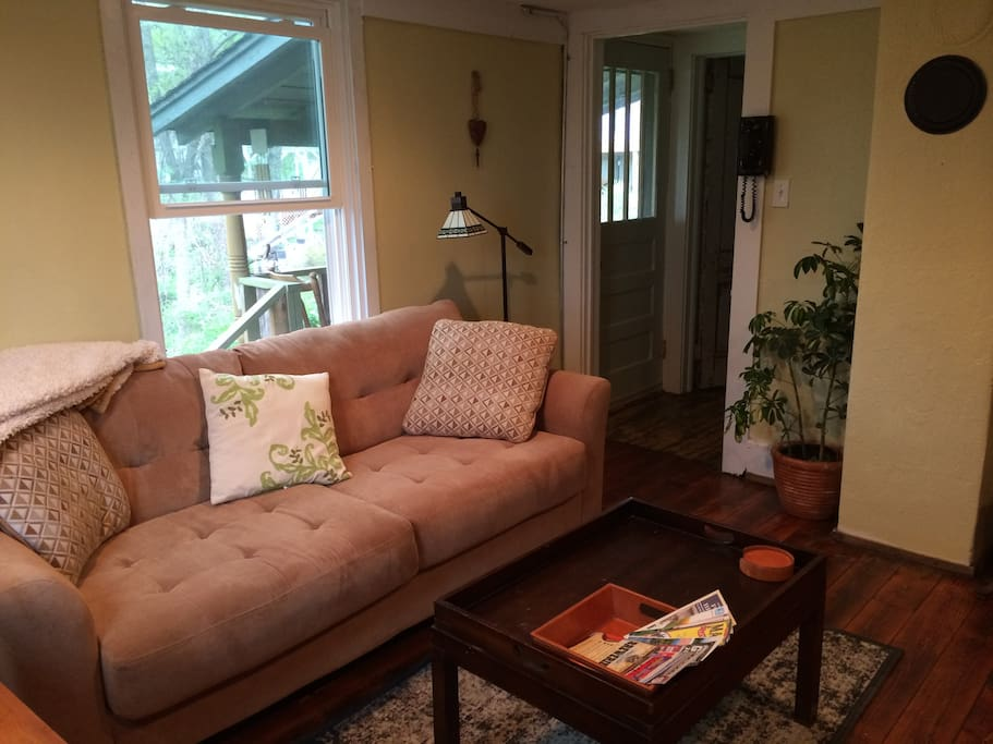 Comfy couch to unwind on after your day of exploring Asheville.
